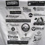 T-shirts covered in event sponsors!