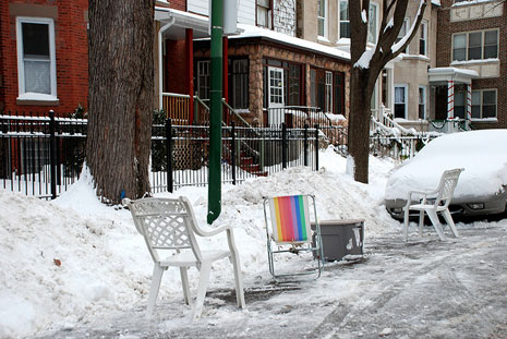 CHicago saving winter parking spots with chairs